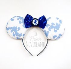 Run Mickey Ears, Mickey Half Marathon Ears, Mickey Running Ears, Mickey Inspired Disney Ears, Disney Marathon Ears, Mickey Ears Headband  Be a part of the magic with these handmade, Disney inspired Run Mickey ears! The ears are covered in a white cotton printed fabric with light blue images of Mickey Running/Jogging. They feature a royal blue sequined bow with a center embellishment of Mickey. The headband itself is covered in royal blue glitter. One size fits most!  A note about the general…