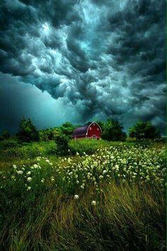 Dark clouds over farmland