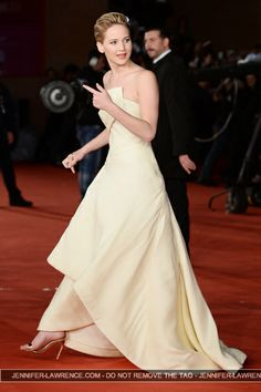Jennifer Lawrence. This dress is gorgeous! Wonder who the designer is?