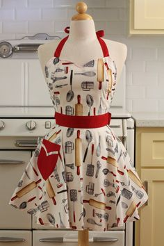 Another one of my daytime entertaining aprons. I just love the pattern on white background and the red pocket, waist, and halter.