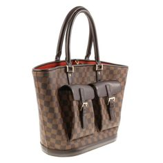 Louis Vuitton Retired Manosque Gm Damier Brown And Red Tote Bag. Get one of the hottest styles of the season! The Louis Vuitton Retired Manosque Gm Damier Brown And Red Tote Bag is a top 10 member favorite on Tradesy. Save on yours before they're sold out!