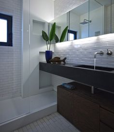 Beautiful remodel of Athens apartment small remodeling project bathroom White Subway Tile Bathroom, Blue Subway Tile, White Subway Tile Backsplash, Beautiful Bathrooms, Modern Bathroom, Small Bathroom, Bathroom Plants, Minimalist Bathroom, Tiled Bathrooms