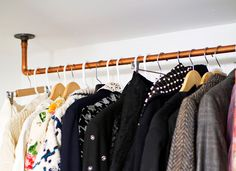 This DIY copper pipe clothing rack mounts directly to the ceiling and can be used to keep heavy sweaters and jackets out of already cramped closets.