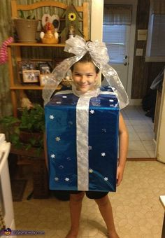 Amy: My daughter Maddy is wearing the costume. She decided that since her sister wanted to be a tree she would be her present. We took a box and cut out...