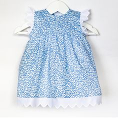 Baby dress in Liberty print with handmade pleats to front by Los Encajeros