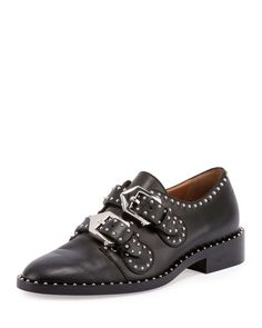 Givenchy menswear-inspired leather oxford with silvertone studding. Flat stacked heel. Round toe. Double-monk straps with statement buckles. Buckle closure. Studded welt. Made in Italy. More