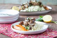 A recipe for gluten-free and Paleo Slow Cooker Moroccan Chicken with Chopped Almonds, Apricots and Cauliflower Couscous