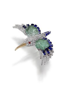 The Jewels in Cartier's L'Odyssée de Cartier Film - this pin is set with brilliant and single-cut diamonds, with wings made of leaf-shaped emeralds and faceted sapphires.