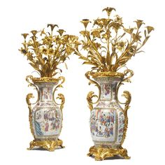 A pair of Napoleon III gilt-bronze mounted Chinese export cantonese enamel seven-light vase candelabra Paris, circa 1870 Estimate — USD LOT SOLD. Candle Chandelier, Antique Chandelier, Antique Lighting, Candelabra, Candlesticks, Chandeliers, Napoleon Iii, Fine Porcelain, Bronze