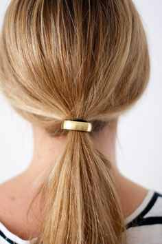 Use a brass ring to DIY this cool hair cuff.
