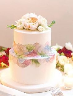Unique two tier watercolor detailed white wedding cake; Featured Cake: Alliance Bakery