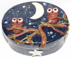 this is a Paper Mache  box covered in polymer clay the moon and stars and the owls eyes glow in the dark