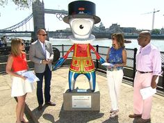 """""""TODAY anchors introduce 2012 Olympic mascot"""" -- the odd thing is, in thumbnail it resembles Snoopy...HOWEVER, that's not an eye or a nose in the middle of the face; it's supposed to be something like a drop of steel representing the Industrial Revolution.  Huh?!!"""