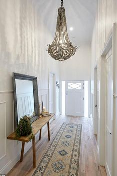 Spacious! Josh and Elyse's hallway dazzled with a massive chandelier and high ceilings