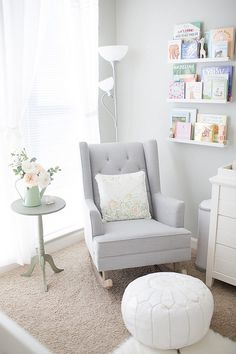 Neutral nursery. Love the ottoman poof and wall book ledges!