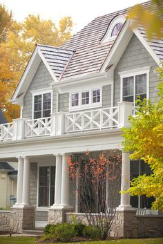 Nantucket Style Exterior......rail across third story, triple window