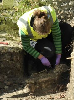 Here is one of the archaeologists working at cleaning up the skeleton of one of our young children from 900 ad Young Children, Crib, Skeleton, Cleaning, Crib Bedding, Little Boys, Baby Crib, Skeletons, Cribs