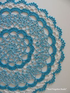 September CAL from the Threadies Facebook group. ~ Shaded Pink and Lavender Doily~ I used size 10 Artiste thread. The colors are Caribbean and Porcelain. For this doily I used 2 strands of thread held together and a size 4 hook. The lighter blue in the center is a combo of the Caribbean and Porcelain.  https://www.pinterest.com/KnotForgottenSt/knot-forgotten-studio/