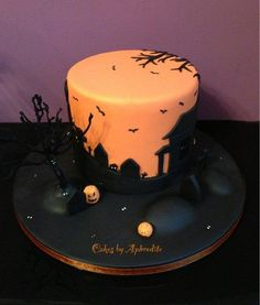 "What else could I do on a cold and windy Friday evening! Having decided I needed a Halloween themed pic for my Facebook page, I set about making something as I went, the cake is a simple 4 layer 6"", the tree is made using florist wires and candy..."