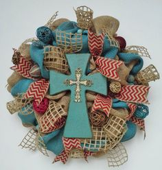 Image from http://img.loveitsomuch.com/uploads/201403/18/ro/robin%20egg%20blue%20wooden%20cross%20natural%20burlap%20easter%20wreath%20with%20chevron%20ribbon%20open%20weave%20burlap%20and%20n-f26235.jpg.