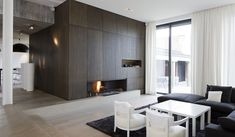 While some interior design elements and trends disappear over time, others adapt and transform. A good example is the fireplace which has never really Placard Design, Cozy Reading Corners, Living Room Setup, Appartement Design, Design Salon, Interior Design Elements, Modern Fireplace, Contemporary Interior, Home And Living
