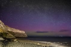 Llandudno Bay with the glow of Aurora Borealis. Photo by Jonny Williams JB Photography