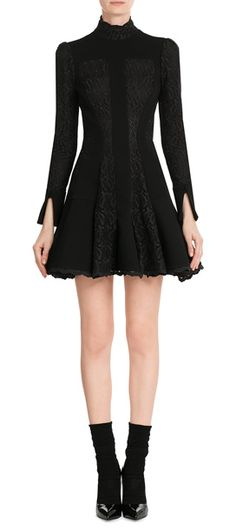 Made from cotton and wool and detailed with inserts of lace, we love the decadent romance of this Alexander McQueen mini dress #Stylebop
