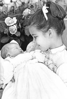 Grace and Family:  Caroline holds her four-day-old little sister, Stephanie, at the Princely Palace. Monaco, February 4, 1965.