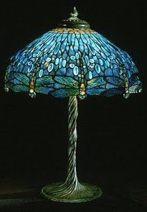 I have this lamp, but with a heavier base. It's one of my very favorite things.