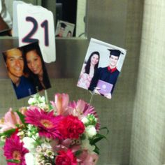 Wedding Centerpiece table numbers corresponded with their pictures at that age.  Nice touch!