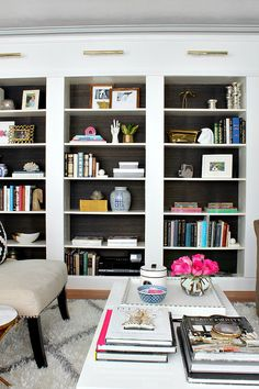 Grasscloth backed bookcases