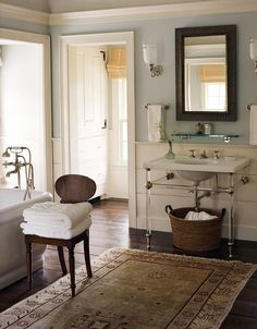 WSH <3 the oushak rug in this neo traditional bathroom.
