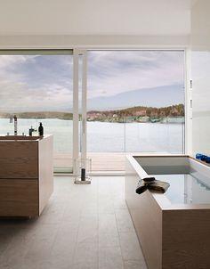 Bath tub. Wood. Tile floor.