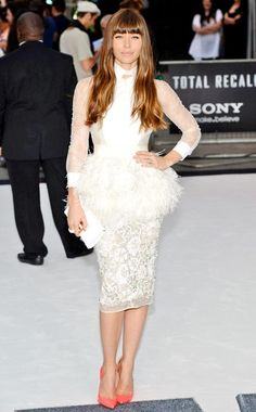 Jessica Biel showed off her flirty feminine side in this gorgeous Giambattista Valli feathered peplum dress, paired with a leather clutch and pretty pink Christian Louboutin heels.