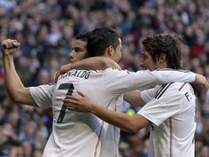 Real Madrid's Colombian midfielder James Rodriguez celebrates with Real Madrid's Portuguese forward Cristiano Ronaldo and Real Madrid's Portuguese defender Fabio Coentrao after scoring during the Spanish league football match Real Madrid CF vs RCD Espanyo Jan 10/15