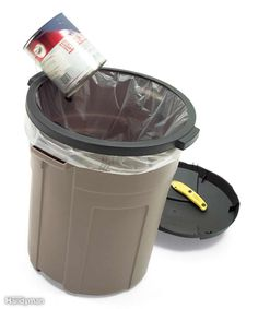 Tired of the garbage bag slipping down into the trash can? Cut out the middle of the lid with a utility knife and just snap the outer rim over the bag to keep it in place. This works great for recycling, not so great for stinky stuff!