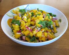 MANGO SALSA!!!  I like to eat this with tortilla chip!  Also, you can use canned mangos and I add a small amount of ground cumin and about a quarter of a tomato to my recipe.