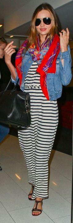 Who made  Miranda Kerr's red print scarf, aviator sunglasses, studded flat sandals, white stripe maxi dress and black handbag that she wore at LAX airport?