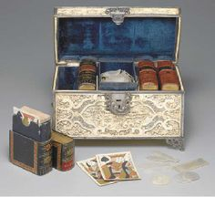 Lot Description  Ivory and silver game box, China, circa 1800.  5 x 9.5 x 5.75 in. (227 x 245 x 148 mm). Intricately carved ivory box. The l...