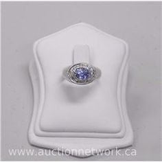 Ladies 14kt White Gold, Genuine Sapphire (1.40ct) and 12 Diamond Ring. (8) - Auction Network