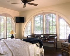 Love the clean lines on the plantation shutters for a curved window