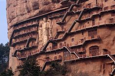 I think I left my cap in apartment - Seven thousand Buddhist sculptures grace the caves and a sheer rock cliff face of the Maijishan Grottoes in Gansu Province, China Rock Sculpture, Sculptures, Way To Heaven, Mystery Of History, Construction, The Monks, China Travel, Historical Sites, Cool Places To Visit