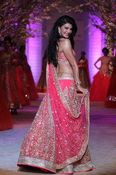 www.amouraffairs.in Indian Bride Lehenga gold border zari zardozi wedding, bridal, bride, lehenga, gorgeous, elaborate, wow, pink, golden details, hairstyle, pretty @Asli_Jacqueline Fernandez gorgeous @ India Bridal Fashion Week 2014 #Desi #Lehenga