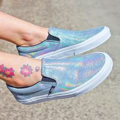 The Matte Iridescent Classic Slip-On features a low profile iridescent slip-on upper, padded collar and heel counters, elastic side accents, and signature waffle outsoles.