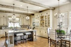 Love the fantastic glass front cabinets down to the countertops!