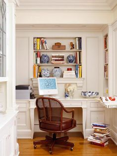 Out-of-View Office Space  This home's office space is tucked into an alcove adjacent to the kitchen pantry -- safely out of view of gathering areas so there's no pressure to keep things perfectly neat. The space is used for everything from work to menu planning, and it's also a place for the homeowners to display their Asian antiques.