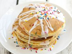 """Eating these I felt like Will Ferrell in the Elf movie with his """"spaghetti-pop-tarts-maple-syrup-M and M's"""" breakfast creation!  The boys and I made these today.  The icing is more brownish due to so much vanilla I added.  One kid liked regular syrup instead.  We used a funfetti cake mix instead and sprinkled mini M and M's on top.  These would make a special start to a child's birthday."""