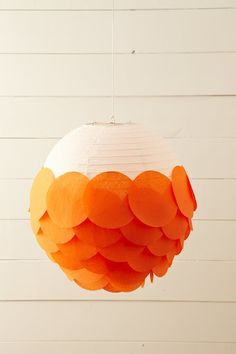 via Martha Stewart: all you need is a basic lantern, tissue paper, circles, and double-sided tape. So simple and cute, right?!