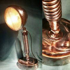 Desk lamp made from a Lucas headlight and a Harley Davidson suspension spring. Lovely burnished steel base as well. #industrial #machine #handcrafted #Lamp