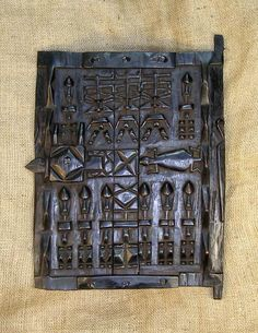 African Doors - Dogon Door 4  African Doors and masks of the Dogon. This African Door from the Dogon tribe of Mali and Burkina Faso measures 18 inches tall and is hand-carved of wood.